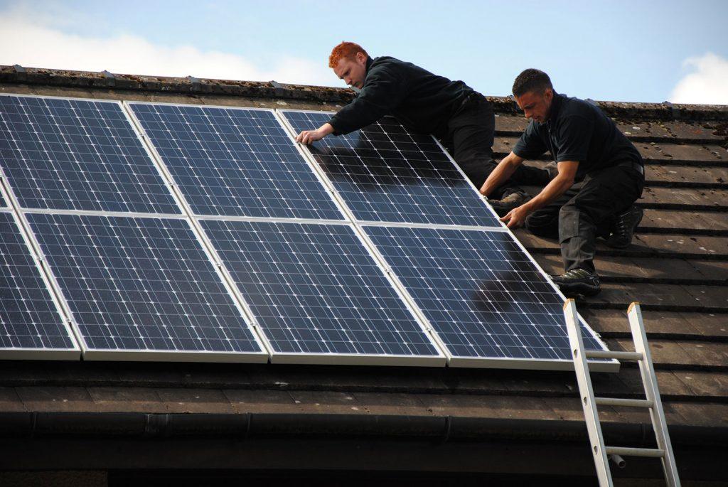 Men installing solar panels on the Busselton home roof