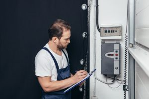 Electrician Inspecting RCD Switch
